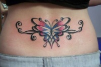 Coloured butterfly tattoo on lower back