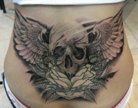 Cool idea of skull tattoo on lower back