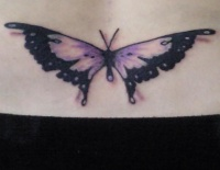 Lower back tattoo,violet  flattened butterfly