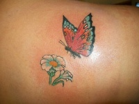 Lower back flower tattoo, flying beautiful butterfly