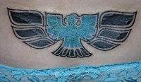 Lower back tattoo design, blue, styled bird, black wings
