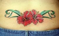 Tattoo on lower back, beautiful, red flowers styled