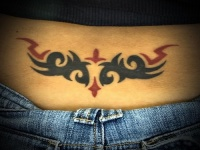 women lower back tattoo